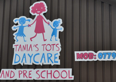 tanias-tots-wall-sign